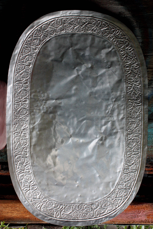 Пуансировка   (выколотка объема с обратной стороны листа)