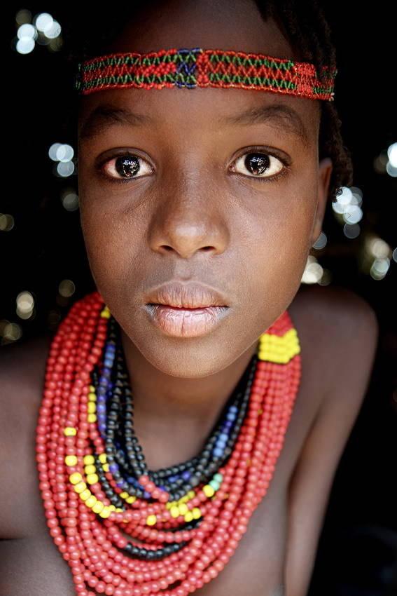 Девушка из племени Дассанеч проживающих на юге Эфиопии в долине реки Омо