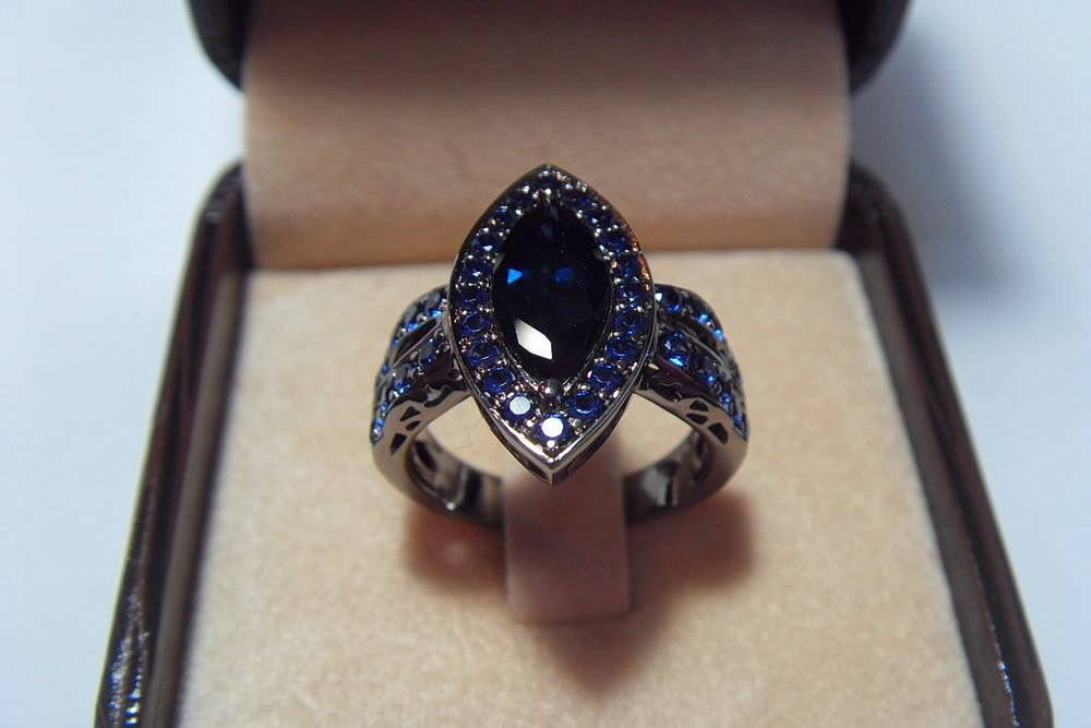 "Ring ""Thai"". Gold, sapphire 1.68 carats and small sapphires, black rhodium"
