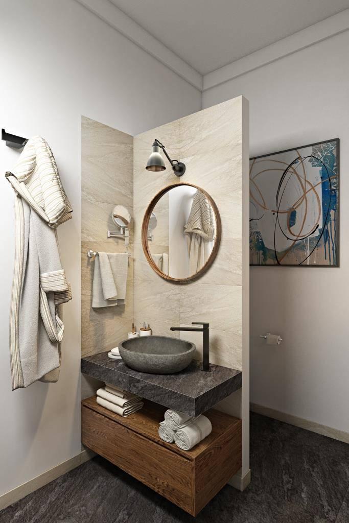Небольшое уединение зоны туалета достигнута возведением не высокой стены, на которой прекрасно расположилась раковина с зеркалом. Тем самым основная площадь ванной комнаты выглядит более эстетично