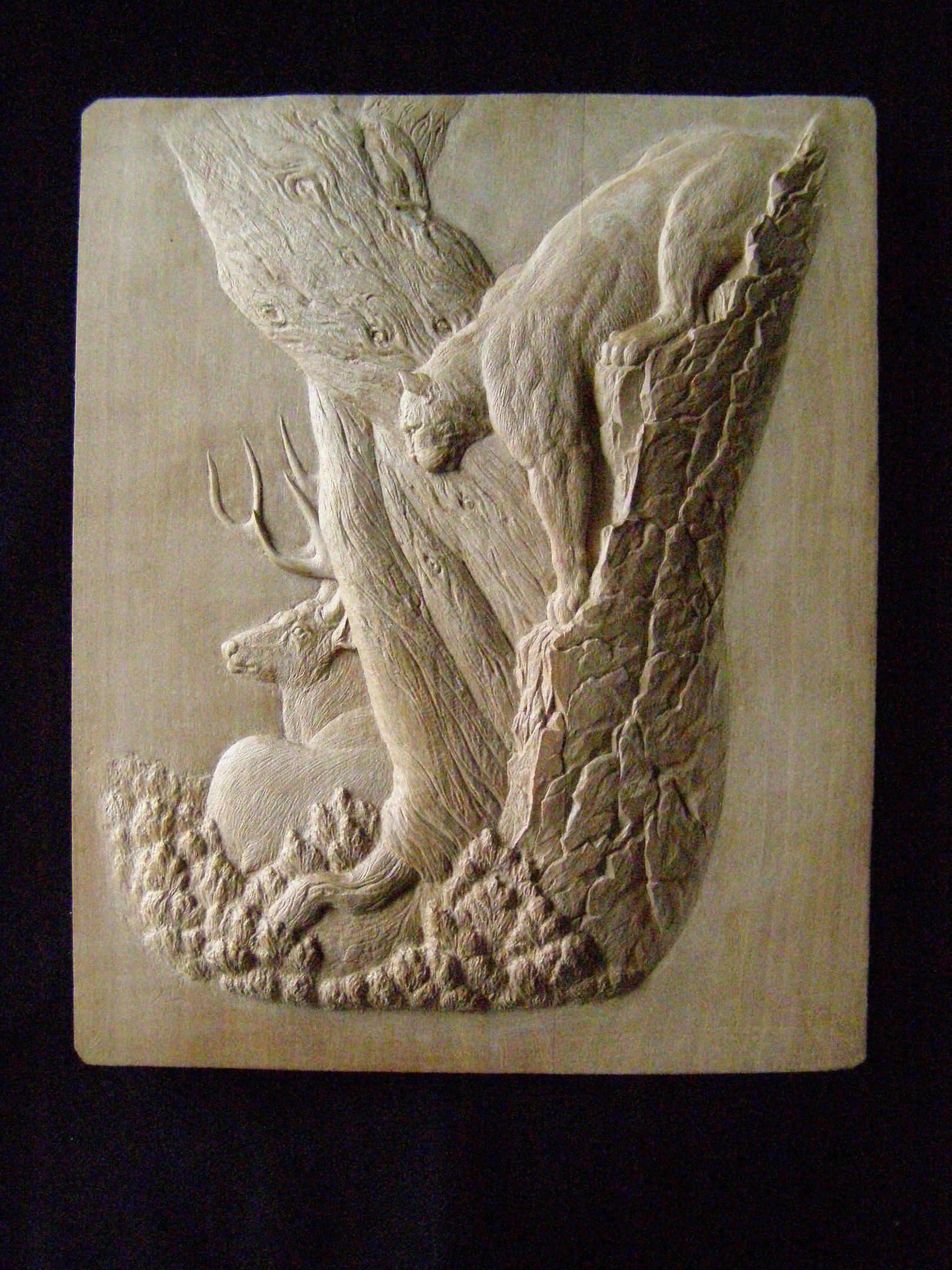 """ Lioness on hunt "". Material: wild pear. Size: 18сm х 15сm. Relief height: 6 mm. Handwork. March, 2013."