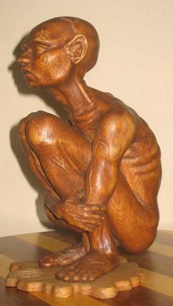 Скульптура .Высота 25 см.Красное дерево