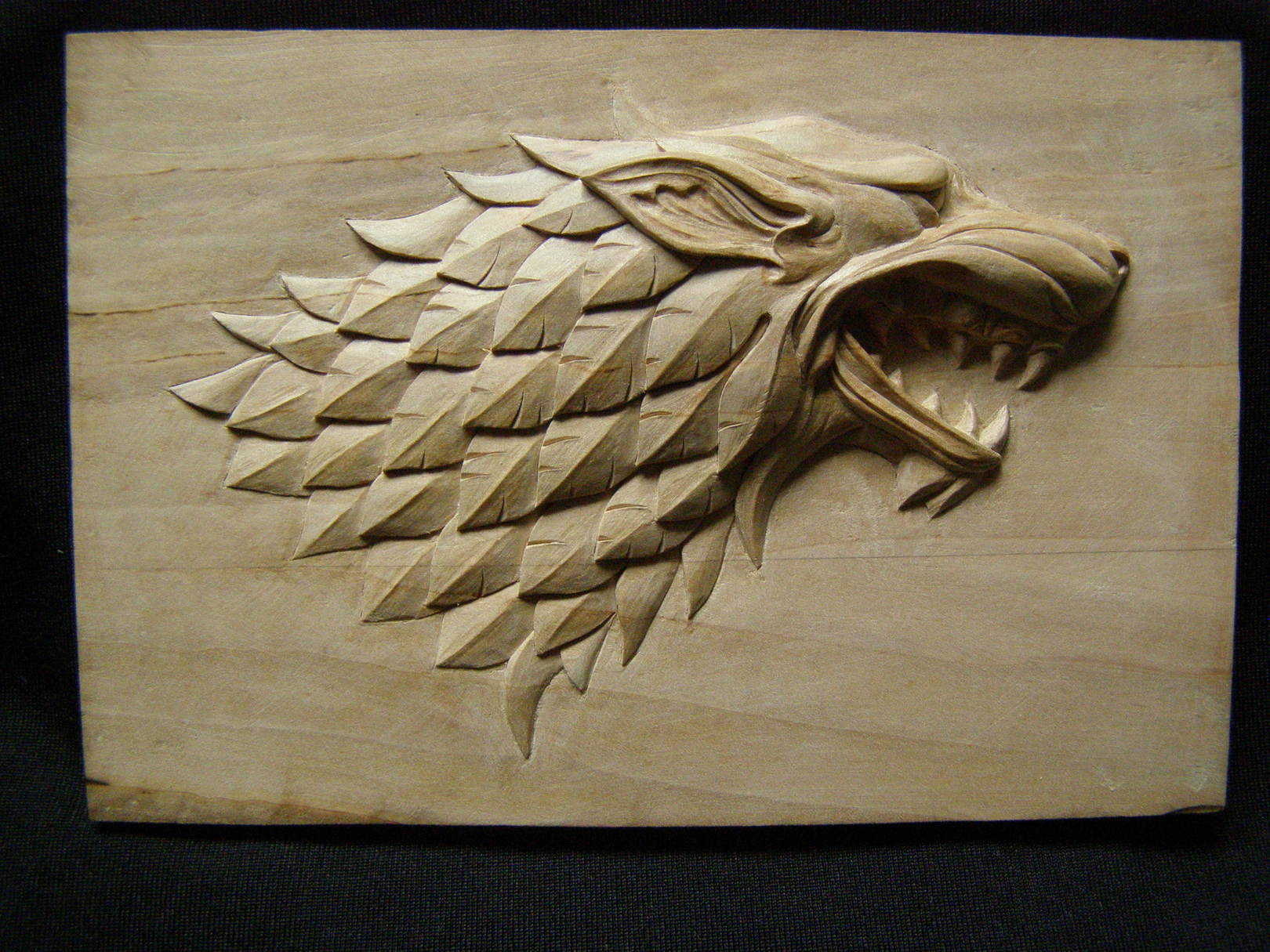 """Master-Model """" WOLF-GRIFON """" from wood. Material: pear-tree. Size:  8cm x 12cm.  Relief height 9 mm.  2015 year."""