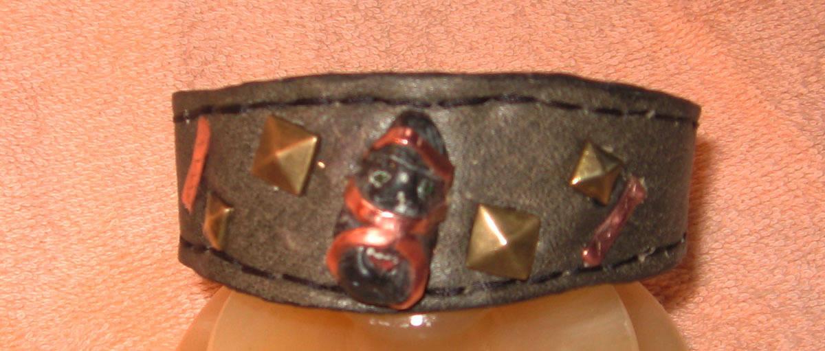 """""""Джин""""материал:нат кожа,медь,камень гранит."""